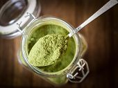 Постер, плакат: Moringa powder in a jar
