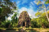 pic of ancient civilization  - Ancient Khmer pre Angkor architecture. Sambor Prei Kuk temple ruins with giant banyan trees under blue sky. Kampong Thom Cambodia travel destinations