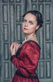 picture of pompous  - Portrait of young beautiful medieval woman in red dress - JPG
