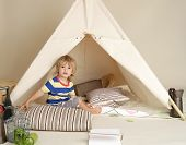 picture of teepee  - Child playing at home indoors with a teepee tent - JPG
