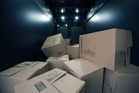 picture of moving van  - Cardboard Moving Boxes in the Large Commercial Van Cargo Area - JPG