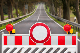 foto of safety barrier  - Red and white colored street barrier at an empty road - JPG