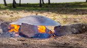 "picture of pita  - ""Tabun"" a traditional way of making daruze pita bread outdoors - JPG"