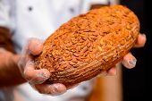 Постер, плакат: Bread in the hands of baker