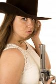 stock photo of pistols  - Tough cowgirl holding pistol staring down expression - JPG