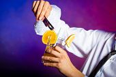 picture of bartender  - Young stylish man bartender preparing serving alcohol cocktail drink - JPG