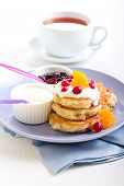 picture of buttermilk  - Buttermilk muesli pancakes with fruits and berries - JPG