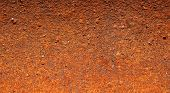 stock photo of scrap-iron  - Background texture of a heavily corroded and rusted piece of scrap metal - JPG
