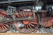 pic of locomotive  - View of wheels of classic steam locomotive - JPG