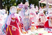 pic of rag-doll  - Many handmade colorful dolls made of fabric and straws - JPG