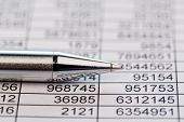 stock photo of revenue  - a table with the figures of revenue and expenditure - JPG