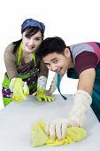 picture of spring-cleaning  - Attractive asian couple using spring cleaning tools to clean a table - JPG