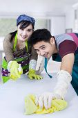 picture of spring-cleaning  - Portrait of asian couple cleaning a table with spring cleaning tools at home - JPG