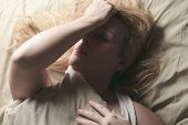 foto of whore  - A woman feel sick lying down on bed - JPG