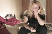 pic of alcoholic drinks  - A alcoholic woman drinking beer in his bedroom - JPG