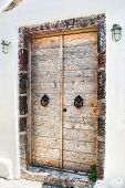 picture of greek-architecture  - Old wooden door of the house - JPG