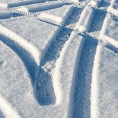 image of snowy-road  - snowy winter road with tire markings and blue sky - JPG