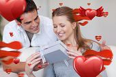 pic of she-male  - Woman opening the gift she got from her boyfriend against love heart pattern - JPG