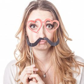 picture of emoticon  - Young woman with mustache playing various emotions in studio emoticons - JPG
