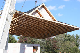 image of trussle  - Crane lifts roof onto prefab town home - JPG