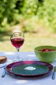 foto of marsala  - spinach in marsala color plate with tomatoes brown bread and wine - JPG