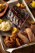 pic of ribs  - Barbecue Smoked Brisket and Ribs Platter with Pulled Pork and Sides - JPG