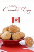 picture of canada maple leaf  - Stack of donut holes on red plate on Canadian maple leaf flag for Happy Canada Day celebration party - JPG