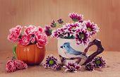 foto of carnation  - still life flowers Chrysanthemum and carnation in vase - JPG