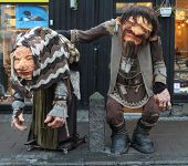 stock photo of troll  - Over Life Sized Traditional Male and Female Troll Figures Public Art Installation Sculptures Standing on Street in Reykjavik Iceland - JPG