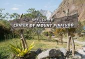 image of luzon  - Welcome Sign at Entrance to Pinatubo Lake a Crater Lake Formed by Eruption of Mount Pinatubo in Cabusilan Mountains in Luzon Philippines - JPG