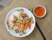 picture of nuong  - Pork grilled spring rolls and fresh sausages with rice noodle and vegetable Vietnamese typical cuisine so called BUN THIT NUONG - JPG