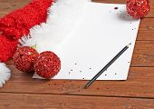 pic of letters to santa claus  - Letter to the Santa Claus composition of the copyspace blank sheet of paper next to multiple Christmas decorations over the wooden surface - JPG