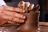 image of pottery  - hands working on pottery wheel - JPG
