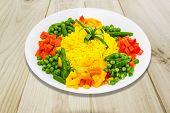 stock photo of boil  - White dish with boiled rice cooked with turmeric with boiled vegetables  - JPG