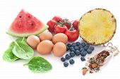 image of cellulite  - Anti cellulite foods including tomatoes spinach blueberries watermelon seed mix and eggs over a white background - JPG