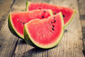 picture of watermelon slices  - Watermelon slices on the wooden table close up - JPG