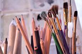 picture of bristle brush  - Paintingdrawing and sketching tools. Graphite and charcoal pencils for fine art in the middle and blending stumps or tortillons for blending pencil drawings to the left. Bouquet of colorful brushes of different types and sizes to the right. ** Note: Shal - JPG