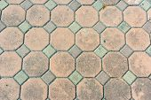 stock photo of octagon  - Brown Octagon Brick connect with green square path background - JPG