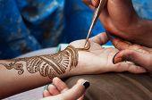 pic of street-art  - Painting Henna paste on woman - JPG