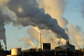 image of belching  - smokestacks from a factory spewing smoke and pollution into the air - JPG
