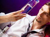 image of vodka  - Young stylish man bartender preparing serving alcohol cocktail drink pouring vodka filling a jigger  - JPG