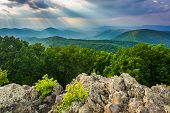 stock photo of virginia  - Crepuscular rays over the Blue Ridge Mountains seen from Loft Mountain in Shenandoah National Park Virginia - JPG