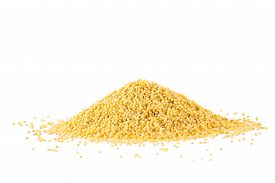 stock photo of millet  - Heap of millet isolated on white background - JPG