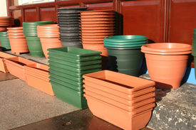 stock photo of flower pot  - plastic flower pots and holders outside a shop - JPG