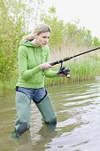 pic of fisherwomen  - woman fishing in pond in spring country - JPG