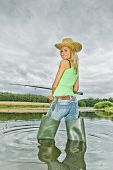picture of fisherwomen  - woman fishing in pond in green spring country - JPG