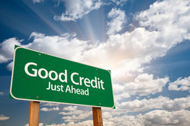 stock photo of debt free  - Good Credit Green Road Sign with Dramatic Clouds - JPG