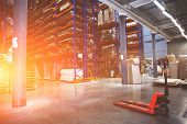 Large Modern Industrial Logistic Warehouse With Forklifts, Sunlight Toned poster