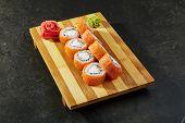 Philadelphia Sushi Roll - Maki Sushi with Philadelphia Cheese inside. Salmon outside poster