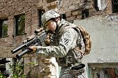 image of trooper  - Soldier in the action in some urban ruins - JPG